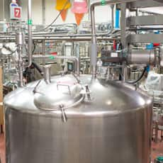 Image of inside the factory and a blending tank