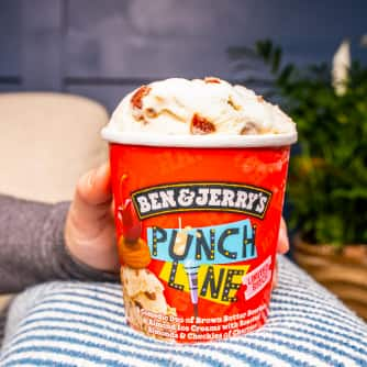 An pint of Punch Line™ Ice Cream being held on a pillow