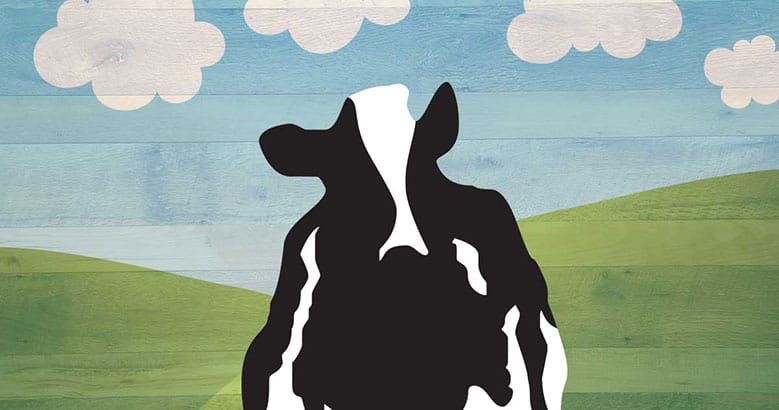 Decorative image of Woody the cow standing in front of green hills and blue skyies