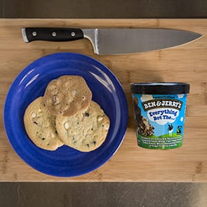 A Plate of cookies, pint of ice cream, and a knife
