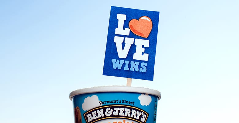 A pint of ice cream with LOVE WINS sign stuck in it