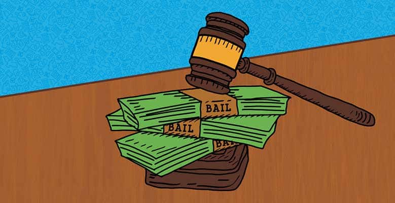 A gavel on top of money marked bail