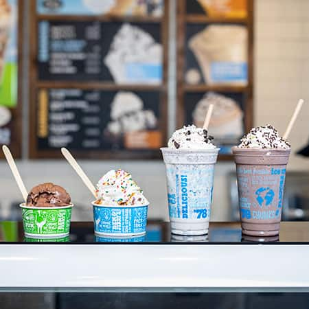A milkshake, smoothie, sundae, and a cup of ice cream