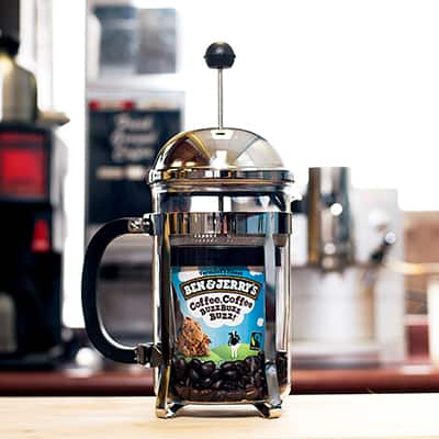 A Pint of Ben& Jerry's Coffee Coffee BuzzBuzzBuzz in a coffee grinder
