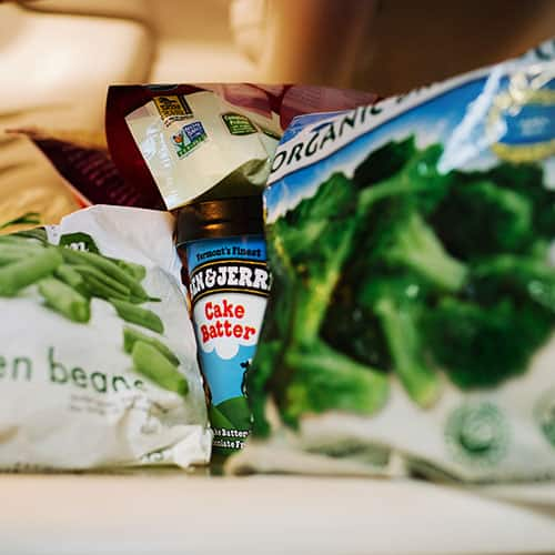 A Pint hidden behind bags of vegetables