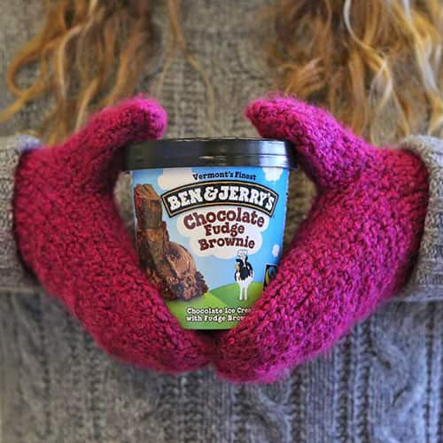 Wearing mittens holding a pint of Ben & Jerry's