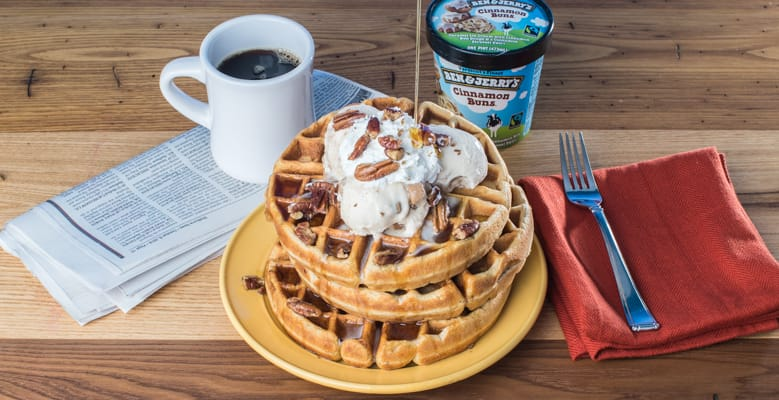 Table with Pint of Cinnamon Buns and waffles