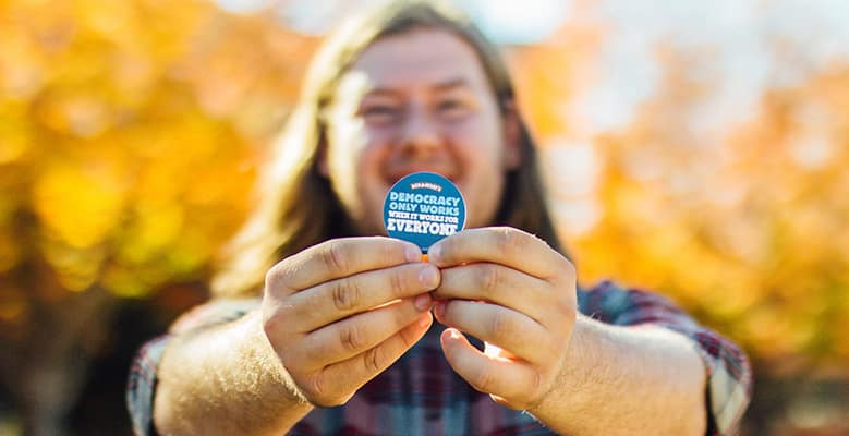 Man with sticker, Ben & Jerry's democracy campaign