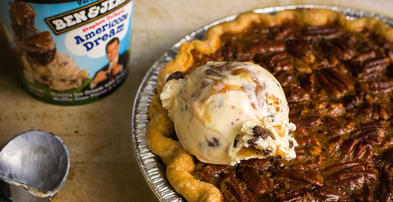 Pint of Ben & Jerry's Americone Dream ice cream next to a pie