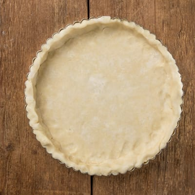 Crust pressed into the tart pan