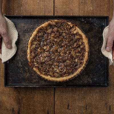 Cooked tart coming out of oven
