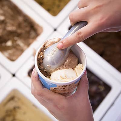 A Picture of putting another scoop of Ice Cream on the other side of the container