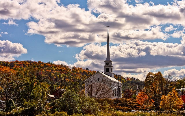 A beautiful church with blue skies and fall colors a blaze on trees