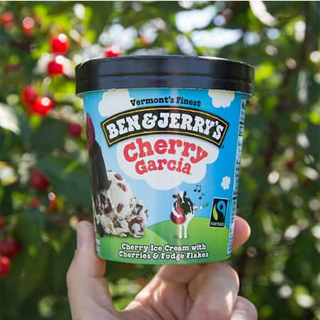 A Pint of Ben & Jerry's Cherry Garcia in an orchard of Cherry Trees