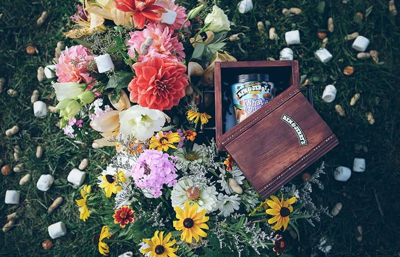 A box with Ben & Jerry's ice cream and flowers