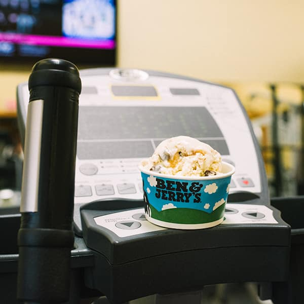 A cup of Ben & Jerry's ice cream on a stationary bike