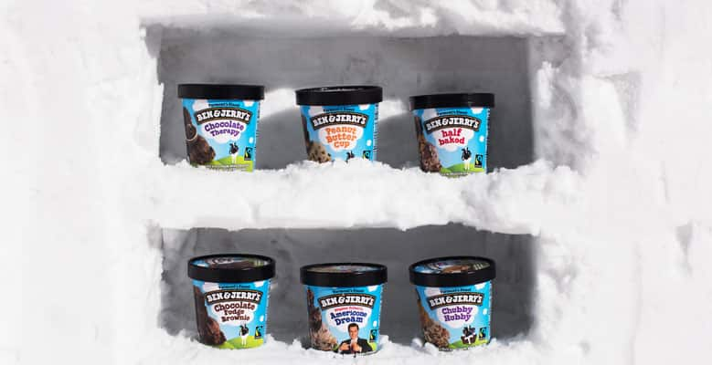 A freezer of snow with pints of Ben & Jerry's