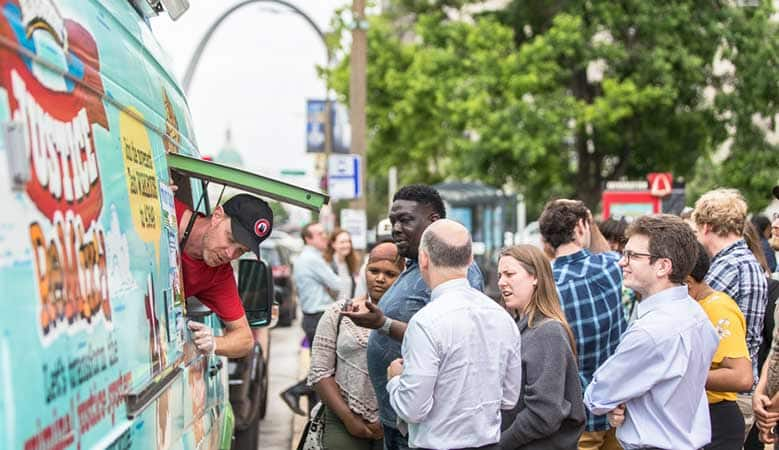 Fans get free scoops at a Ben & Jerry's tour stop in St. Louis
