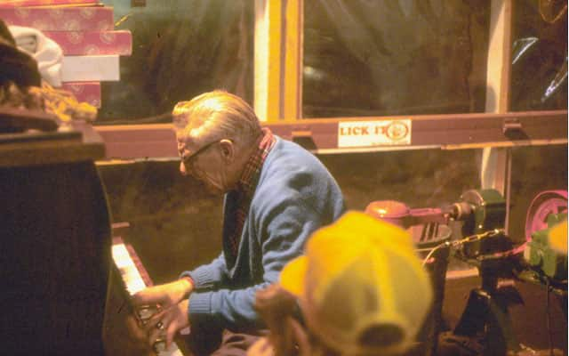 Piano player inside the original Ben & Jerry's.
